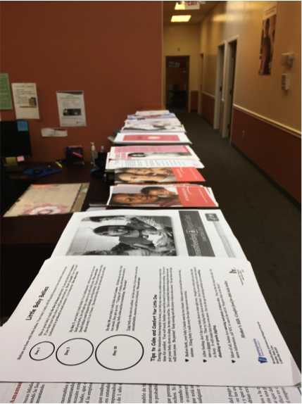 In preparation for the training sessions, stacks of handouts were lined up for the breastfeeding peer counselors.