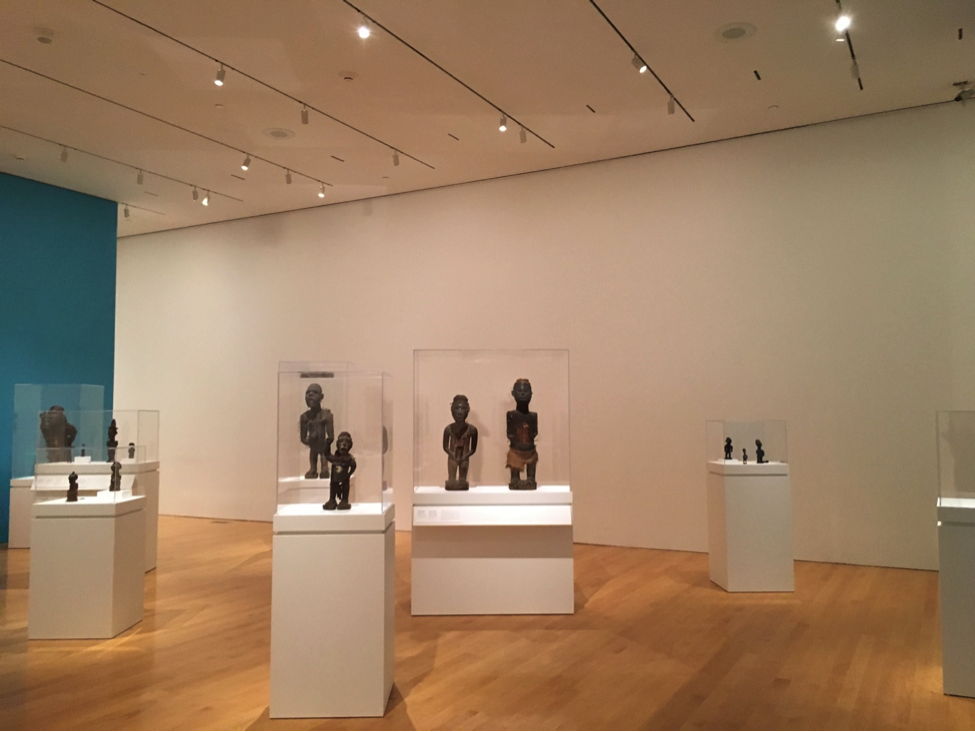 "A picture of the ""Power Figures"" in the exhibit that I took while pretending not to follow visitors."
